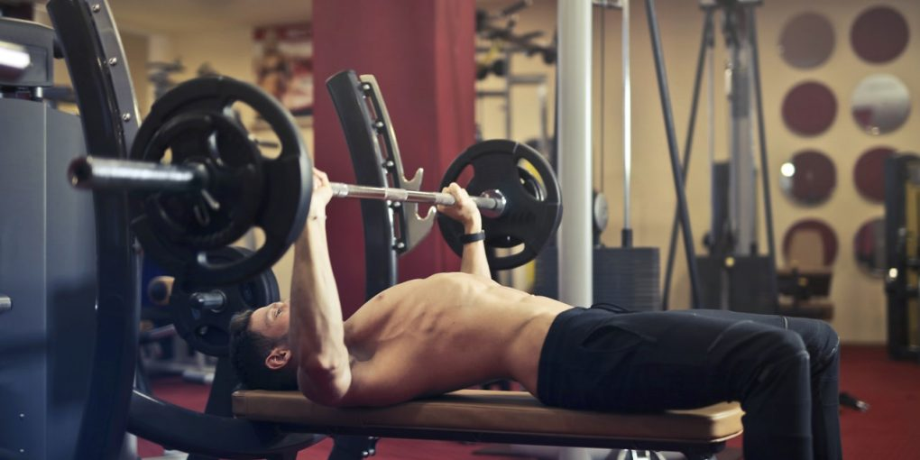man-doing-bench-press